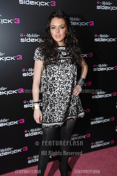 LINDSAY LOHAN at party in Beverly Hills to launch the new limited edition T-Mobile Sidekick 3 designs..October 12, 2006  Los Angeles, CA.Picture: Paul Smith / Featureflash