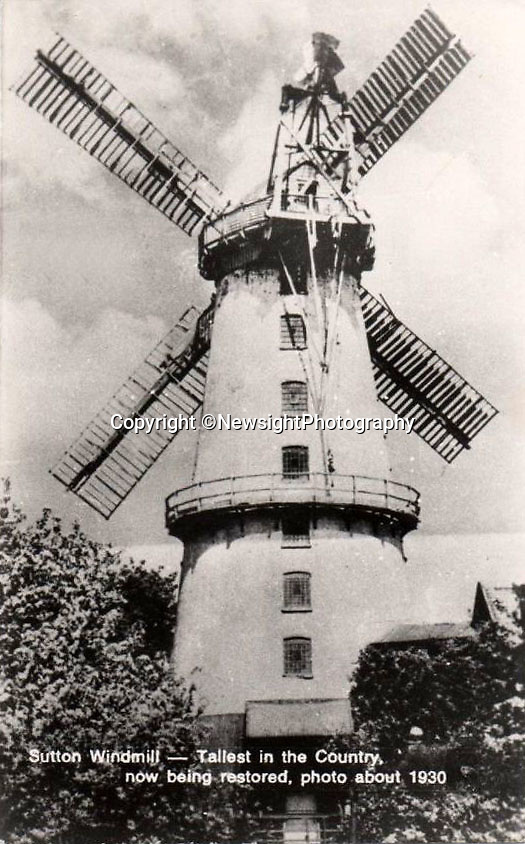 """BNPS.co.uk (01202 558833)Pic: NewsightPhotography/BNPS<br /> <br /> Sutton Mill in the 1930's when it was claimed to be the largest in Britain.<br /> <br /> A campaign to save one of Britain's tallest windmills is in a race against time after the building was put up for auction.<br /> <br /> Campaigners hoping to buy Sutton Mill in North Norfolk and create a millwriting school that would safeguard the future of all UK mills have just seven days left to raise £85,000 so they can put in a bid.<br /> <br /> Steve Temple and Jonathan Cook set up the National Millwriting Centre, a community interest company, to create a skills programme and school to train apprentices and had set their sights on Sutton Mill as the ideal spot.<br /> <br /> Over the last year they have been working towards buying the mill and surrounding grounds and had already secured £450,000 in loans and grants to buy the site.<br /> <br /> But they needed to raise £150,000 in working capital before they can get that money and were working towards this when they were caught off-guard on March 1 as the current owner put the property up for auction """"without warning""""."""