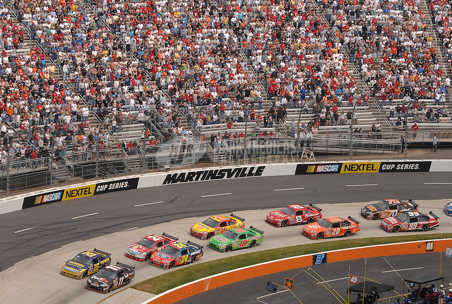 Apr 1, 2007; Martinsville, VA, USA; Nascar Nextel Cup Series drivers Denny Hamlin (11) and Jamie McMurray (26) lead the field to the green flag to begin the Goody's Cool Orange 500 at Martinsville Speedway. Martinsville marks the second race for the new car of tomorrow. Mandatory Credit: Mark J. Rebilas