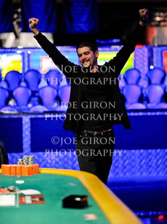Elie Payan throws his arms up in victory after winning event 22.