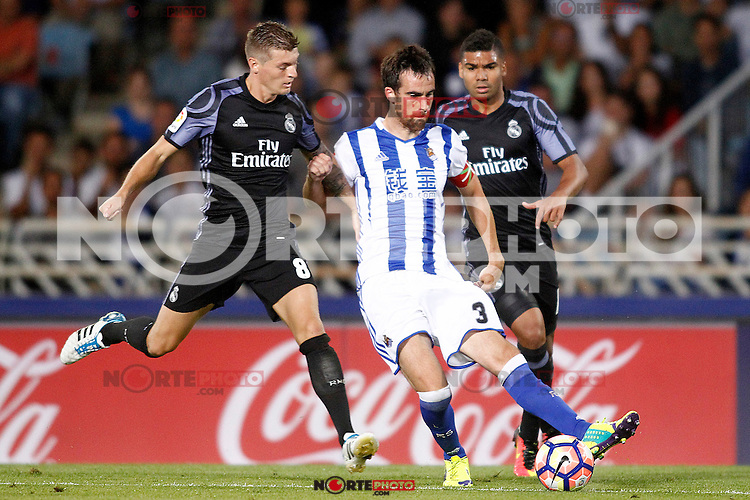 Real Sociedad's Mikel Gonzalez (c) and Real Madrid's Toni Kroos (l) and Carlos Henrique Casemiro during La Liga match. August 21,2016. (ALTERPHOTOS/Acero) /NORTEPHOTO