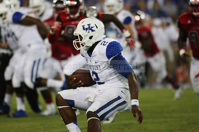 Kentucky Wildcats quarterback Jalen Whitlow (2) runs with the ball during the second half of the football season opener vs. WKU  in Nashville, Tenn., at LP Field on Saturday Aug. 31, 2013. Photo by Emily Wuetcher | Staff