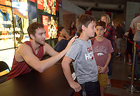 NWA Democrat-Gazette/BEN GOFF @NWABENGOFF<br /> Brachen Hazen, Arkansas freshman forward, signs shirts for Bryson Douglas (left) and Kameron Jaquez, both 9 and from Van Buren, on Sunday Oct. 23, 2016 before the Red-White game at Bud Walton Arena in Fayetteiville.