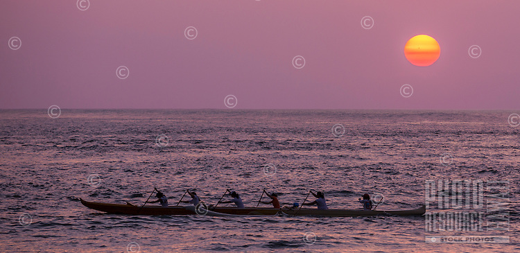 Canoe paddlers at sunset, Haleiwa, O'ahu.