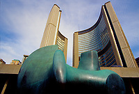 Toronto (ON) CANADA October 2001 - File Photo - .Three-Way Piece No. 2 (The Archer), an abstract bronze sculpture by Henry Moore. in front of Toronto City Hall...The City Hall of Toronto, Ontario, Canada is one of the most distinctive landmarks of the city. Designed by Finnish architect Viljo Revell (with Heikki Castr??n, Bengt Lundsten, Seppo Valjus) and engineered by Hannskarl Bandel, the building opened in 1965; its modernist architecture still impresses today. It was built to replace Old City Hall which was built in 1899....photo by Pierre Roussel - Images Distribution