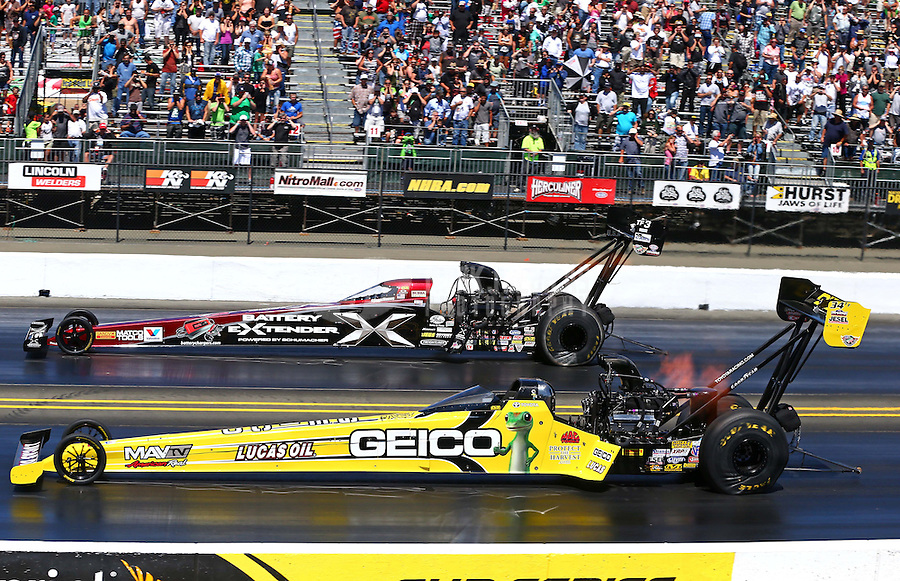 Jul. 28, 2013; Sonoma, CA, USA: NHRA top fuel dragster driver Morgan Lucas (near) races alongside Spencer Massey during the Sonoma Nationals at Sonoma Raceway. Mandatory Credit: Mark J. Rebilas-