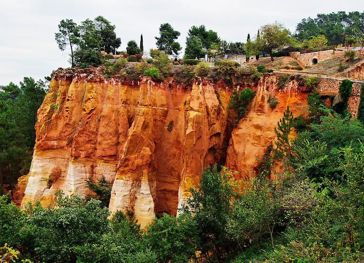 These red and yellow ochre cliffs display the huge beds of ochre on which the village sits and which have been the chief source of its construction materials.