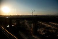 Daytime landscape view from a train of a railway train bridge near Dàtóng Shì Chéng Qū in Shānxī Province, China  © LAN