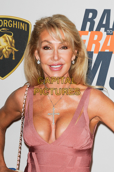 LINDA THOMPSON.The 17th Annual Race to Erase MS at the Hyatt Regency Century Plaza Hotel in Century City, California, USA, .May 7th, 2010.half length beige pink herve leger bandage body con dress cleavage plastic surgery.CAP/ROT.©Lee Roth/Capital Pictures