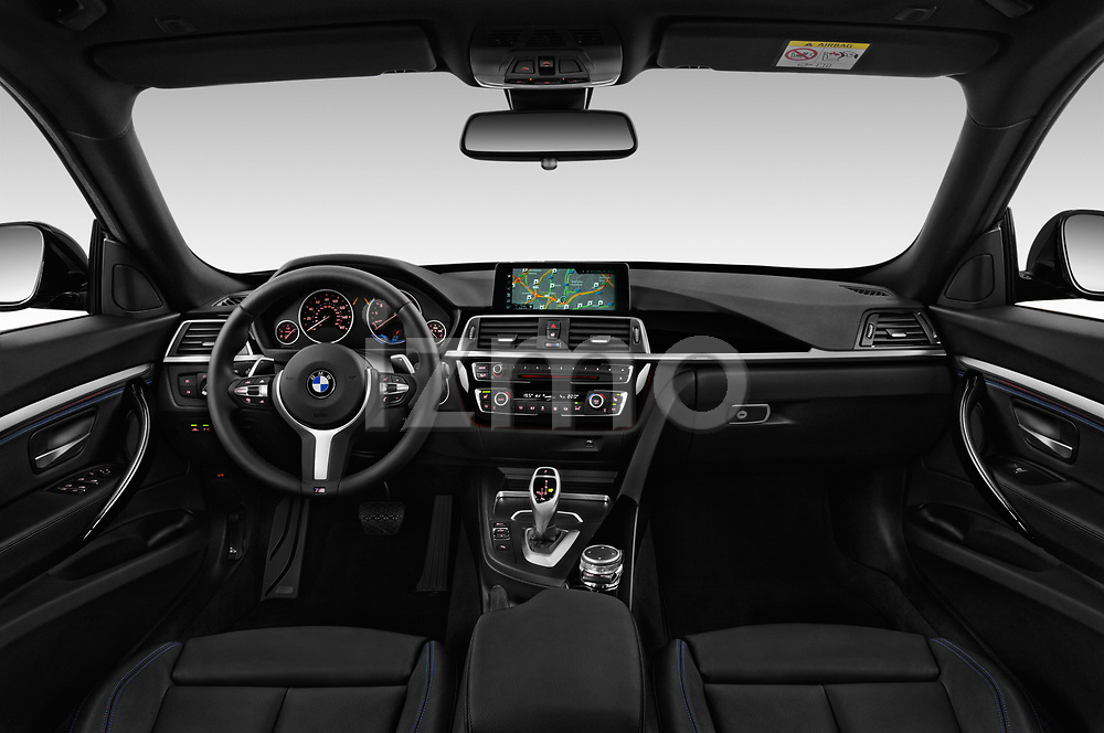 Stock photo of straight dashboard view of 2017 BMW 3 Series 330i GT M Sport 5 Door Hatchback