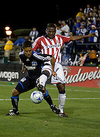 Shavar Thomas (right) extends to steal the ball from Quincy Amarikwa (left). Chivas USA defeated San Jose Earthquakes 1-0 at Buck Shaw Stadium in Santa Clara, California on May 2, 2009.
