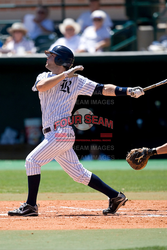 Rice Owls outfielder Michael Aquino #18 swings against the Memphis TIgers in NCAA Conference USA baseball on May 14, 2011 at Reckling Park in Houston, Texas. (Photo by Andrew Woolley / Four Seam Images)
