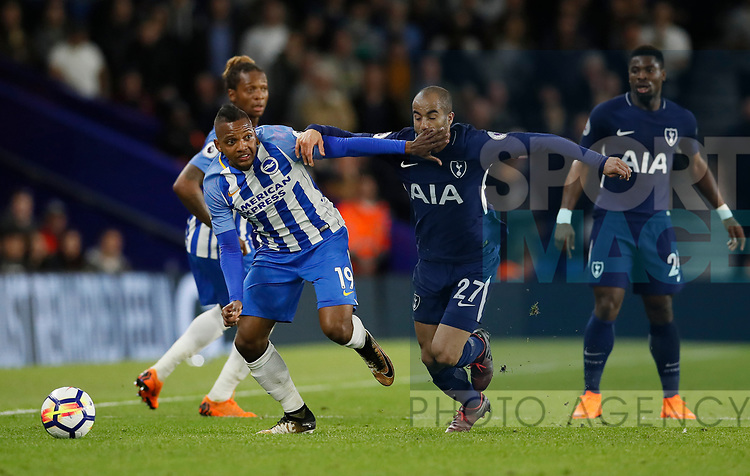 Jose Izquierdo of Brighton holds off Lucas Moura of Tottenham during the premier league match at the Amex Stadium, London. Picture date 17th April 2018. Picture credit should read: David Klein/Sportimage