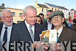Joe Bourke Killarney gets Martin McGuinness to autograph Prelude To freedom 50th anniversary of the 1916 Rising programme during his walkabout in Killarney on Wednesday