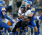 BROOKINGS, SD - OCTOBER 11:  Julian Burton #3 from Missouri State is wrapped up by Nick Mears #42 from South Dakota State in the first half of their game Saturday evening at Coughlin Alumni Stadium in Brookings. (Photo/Dave Eggen/Inertia)