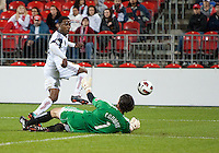 28 September 2010: Real Salt Lake forward Robbie Findley #10 and Toronto FC goalkeeper Jon Conway #1 in action during a CONCACAF Champions League game between Real Salt Lake and Toronto FC at BMO Field in Toronto..Final score was 1-1...