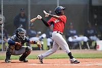 Boston Red Sox minor league second baseman Raymel Flores (5) at bat in front of catcher David Rodriguez during an extended spring training game against the Tampa Bay Rays on April 16, 2014 at Charlotte Sports Park in Port Charlotte, Florida.  (Mike Janes/Four Seam Images)
