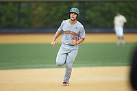Adrian Del Castillo (44) of the Miami Hurricanes rounds the bases after hitting a home run against the Wake Forest Demon Deacons at David F. Couch Ballpark on May 11, 2019 in  Winston-Salem, North Carolina. The Hurricanes defeated the Demon Deacons 8-4. (Brian Westerholt/Four Seam Images)