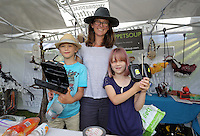 Pictured: Sarah Wygas (C) with son Henry and daughter Martha at Puppet Soup (3rd L) Saturday 13 August 2016<br />Re: Grow Wild event at  Furnace to Flowers site in Ebbw Vale, Wales, UK