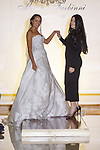 "Fashion designer Maria Farbinni walks runway with model at the close of her Maria Farbinni Haute Couture 2018 ""Westbury Collection"" fashion show, at Panache Bridal New York on October 4th 2017, during New York Bridal Fashion Week Spring 2018."
