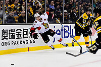 Tuesday, March 21, 2017: Ottawa Senators center Kyle Turris (7) trips over Boston Bruins center Patrice Bergeron (37) during the National Hockey League game between the Ottawa Senators and the Boston Bruins held at TD Garden, in Boston, Mass. Eric Canha/CSM