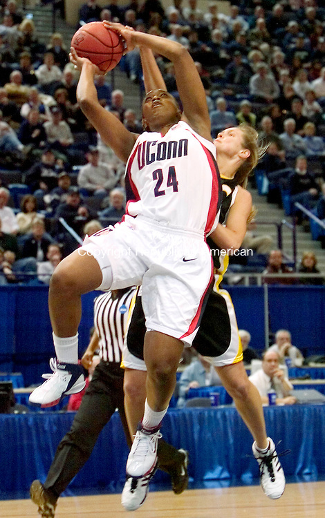 HARTFORD, CT. 18 March 2007-031807SV01--#24 Charde Houston  of UConn goes up for a shot as #12 Sharri Rohde of UMBC defends during the first round of NCAA action at the Civic Center in Hartford Sunday.<br /> Steven Valenti Republican-American