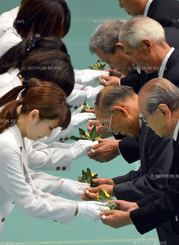 August 15, 2012, Tokyo, Japan - Representatives of the war bereaved families receive chrysanthemums to offer to the war dead during a ceremony marking the 67th anniversary of the end of World War II at Tokyo's Budokan Martial Arts Hall on Wednesday, August 15, 2012. (Photo by Natsuki Sakai/AFLO) AYF -mis-