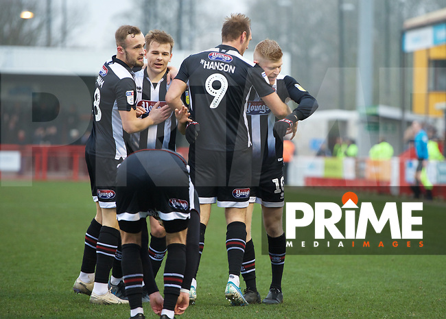 Elliott Whitehouse of Grimsby Town celebrates after scoring the equaliser with his team mates during the Sky Bet League 2 match between Crawley Town and Grimsby Town at The People's Pension Stadium, Crawley, England on 25 January 2020. Photo by Alan  Stanford / PRiME Media Images.