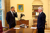 Washington, DC - May 1, 2009 -- United States President Barack Obama talks with Supreme Court Justice David Souter during an Oval Office phone all Friday afternoon, May 1, 2009.  At right is White House Counsel Gregory Craig. .Mandatory Credit: Pete Souza - White House via CNP