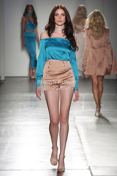 Models walk runway in outfits from the BOSSA Spring Summer 2017 collection for the Fashion Palette Austrialian Swim Resort Spring Summer 2017 fashion show on September 8, 2016.