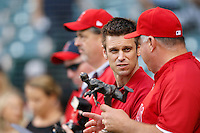 Los Angeles Angels General Manager Jerry Dipoto talks with Angels Manager Mike Scioscia #14 before a game against the Chicago White Sox at Angel Stadium on September 22, 2012 in Anaheim, California. Los Angeles defeated Chicago 4-2. (Larry Goren/Four Seam Images)