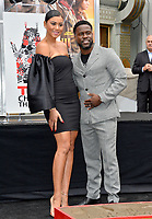 LOS ANGELES, USA. December 10, 2019: Kevin Hart & wife Eniko Parrish at the handprint & footprint ceremony for Kevin Hart at the TCL Chinese Theatre.<br /> Picture: Paul Smith/Featureflash