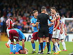 Chris Basham of Sheffield Utd is sent off for a tackle on Neil Bishop of Scunthorpe Utd during the English League One match at Glanford Park Stadium, Scunthorpe. Picture date: September 24th, 2016. Pic Simon Bellis/Sportimage