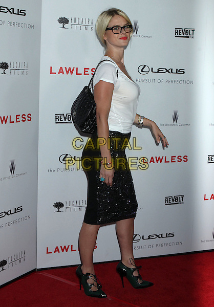 "Alice Eve.""Lawless"" premiere held at ArcLight Cinemas, Hollywood, California, USA..August 22nd, 2012.full length white top black skirt knotted t-shirt beads beaded strappy sandals glasses bag purse side.CAP/ADM/RE.©Russ Elliot/AdMedia/Capital Pictures."