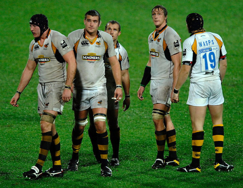 Photo: Richard Lane..Saracens v London Wasps. EDF Energy Anglo Welsh Cup. 01/12/2006. .Wasps' players look up to the scoreboard. (lt to rt) George Skivington, Matt Corker, Mark McMillan and  Martin Purdy.