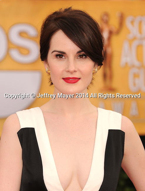 LOS ANGELES, CA- JANUARY 18: Actress Michelle Dockery  arrives at the 20th Annual Screen Actors Guild Awards at The Shrine Auditorium on January 18, 2014 in Los Angeles, California.