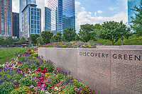 Another view of the Discovery Green with these wonderful flowers display at the entrance you can the city high rise buildings that surround the park in downtown Houston.