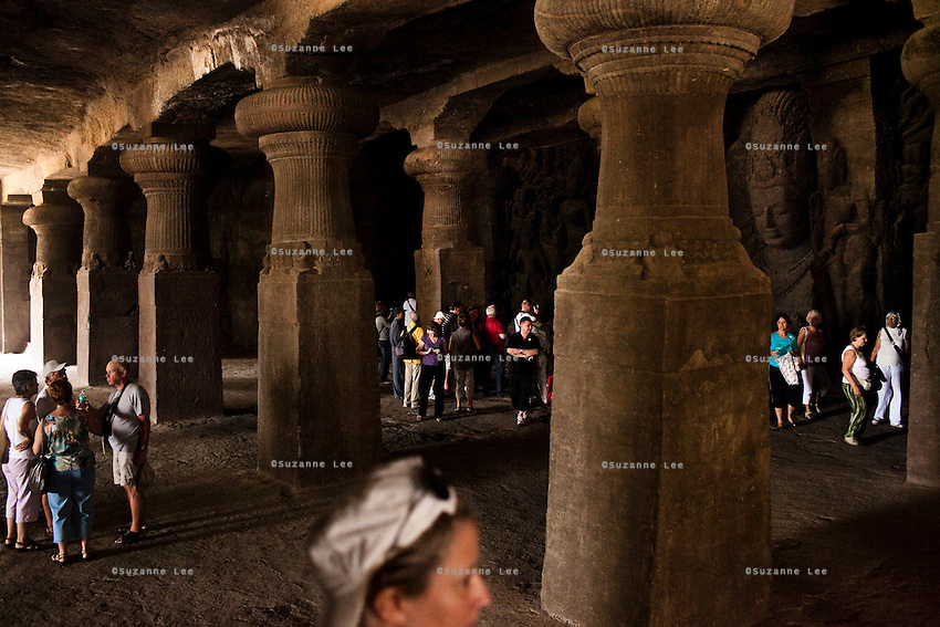 Tourists in the Elephanta Caves, a Hindu place of worship for the Lord Shiva, accessible by a long ferry ride in the Arabian sea, Mumbai, India. Photo by Suzanne Lee