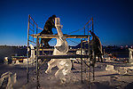 Ice carving taking place at night at Yellowknife's long John Jamboree.