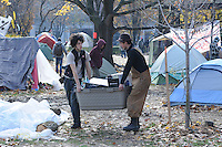Morning of November 15, 2011, two protesters clearing belongings out of the Occupy Toronto Protest Tent Camp at St. James Park, one month in.  This morning the protesters were served eviction notices requiring them to vacate the park by 12:01am November 16, 2011.
