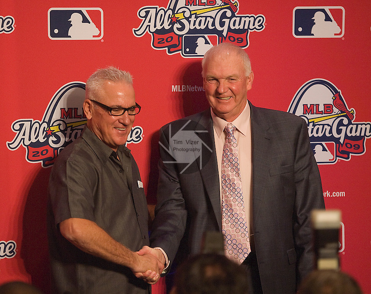 071309tvmanagersshake.Managers for the 2009 Major League Baseball All Star Game teams shake hands after a press conference at the Hyatt Regency Riverfront Hotel in downtown St. Louis.  At left,  Joe Maddon, who will manage the American League team, and at right, Charlie Manuel who will manage the National League team..PHOTO BY TIM VIZER/BELLEVILLE NEWS-DEMOCRAT/MCT