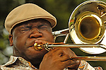 Big Sammie Williams with Big Sam's Funky Nation plays trombone at Sun Sets Concerts series downtown Friday evening.  Bob Gathany photo.