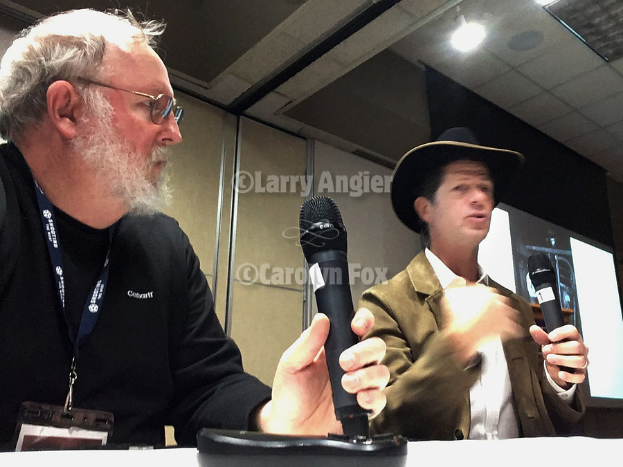 Keynote presenter John Langmore discusses his work, Open Range, with STW's Larry Angier during the Friday symposium at STW XXXI, Winnemucca, Nevada, April 12, 2019.<br /> .<br /> .<br /> .<br /> .<br /> @shootingthewest, @winnemuccanevada, #ShootingTheWest, @winnemuccaconventioncenter, #WinnemuccaNevada, #STWXXXI, #NevadaPhotographyExperience, #WCVA