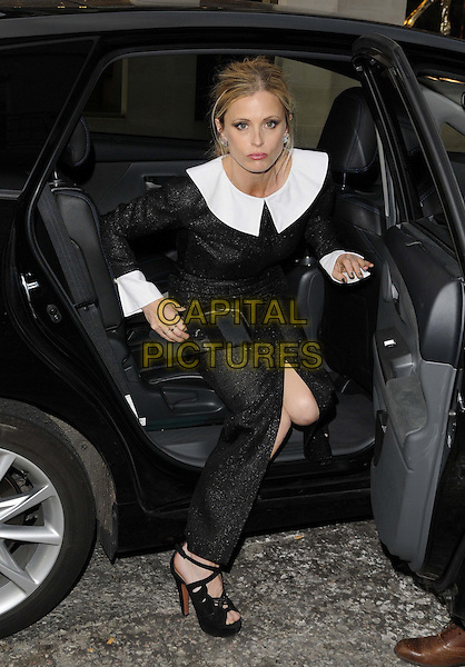 Laura Bailey<br /> The Chanel new flagship boutique launch party, Chanel, New Bond St., London, England.<br /> June 10th, 2013<br /> full length black dress white collar cuffs car bending leaning slit split clutch bag<br /> CAP/CAN<br /> &copy;Can Nguyen/Capital Pictures