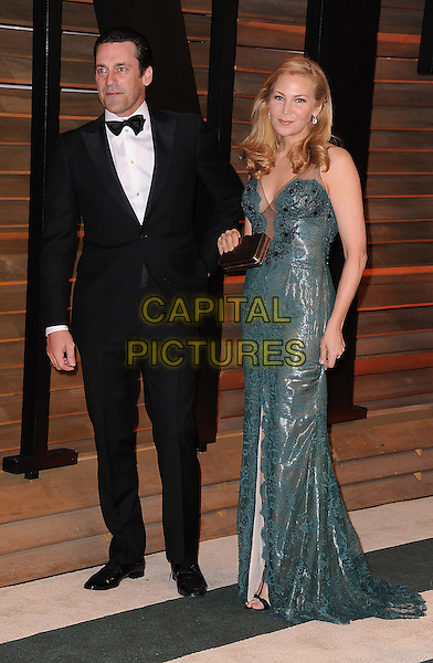 WEST HOLLYWOOD, CA - MARCH 2: Jon Hamm and Jennifer Westfeldt arrive at the 2014 Vanity Fair Oscar Party in West Hollywood, California on March 2, 2014.<br /> CAP/MPI<br /> &copy;MPI213/MediaPunch/Capital Pictures