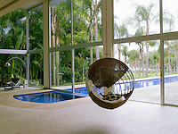 The 82 ft swimming pool extends into the large living room which is furnished sparsely with a few chosen pieces