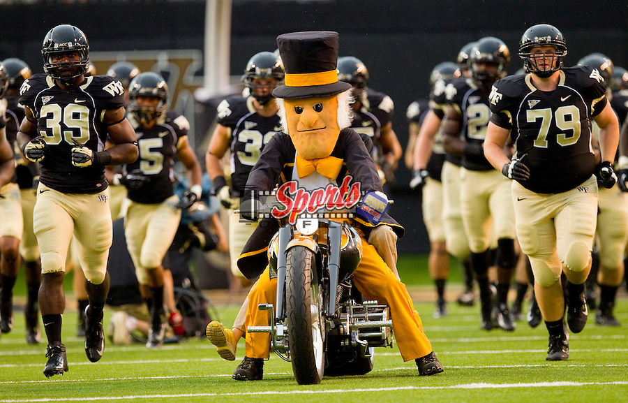 The Wake Forest Demon Deacon mascot leads the football team on to the field prior to the game against the Liberty Flames at BB&T Field on September 1, 2012 in Winston Salem, North Carolina.  The Demon Deacons defeated the Flames 20-17.  (Brian Westerholt/Sports On Film)