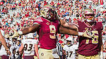 Florida State running back Jacques Patrick (9) and offensive lineman Rick Leonard celebrate Patrick's touchdown in the 2nd half of an NCAA college football game against Louisiana Monroe in Tallahassee, Fla., Saturday, Dec. 2, 2017. Florida State defeated Louisiana Monroe  (AP Photo/Mark Wallheiser)