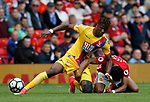 Wilfried Zaha of Crystal Palace and Demitri Mitchell of Manchester United clash during the English Premier League match at the Old Trafford Stadium, Manchester. Picture date: May 21st 2017. Pic credit should read: Simon Bellis/Sportimage