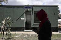Pictured: A woman walks by the worship area building Friday 26 February 2016<br />